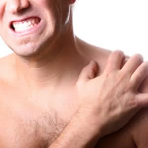 Man Holding Sore Muscles